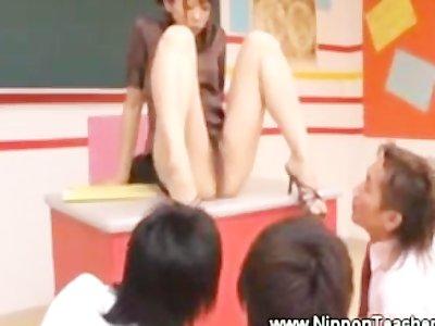 Asian teacher gives upskirt view
